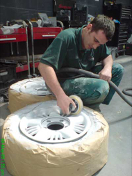 photo of person refurbishing alloy wheels using TTP Flexifill primer, filler and undercoat aerosol