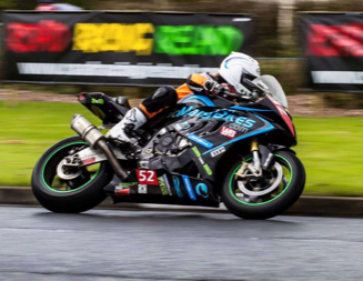 photo of Rob Barber on his motorbike racing at Oulton Park with TTP logo