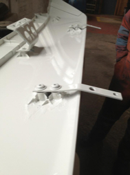 close up of plastic lug repair on truck wind deflector repaired using TTP90 instant plastic repair