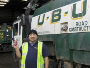 photo of fitter from UBU roadsweepers holding bottle of TTP threadlock part number TLK2001