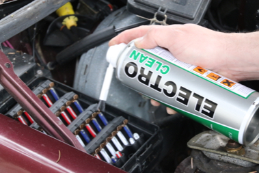 close up of electrical contact cleaner being used in fuse box of car part TTP Electroclean