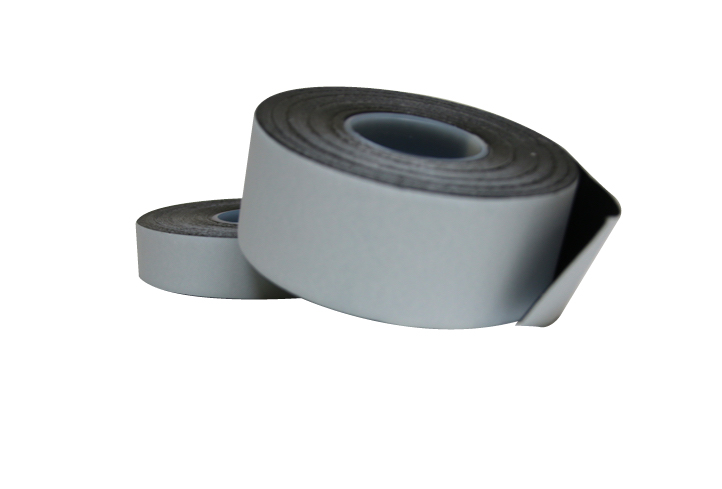 Close up photo of 2 x TTP POWERTAPE different sizes black rubber based amalgamating tape