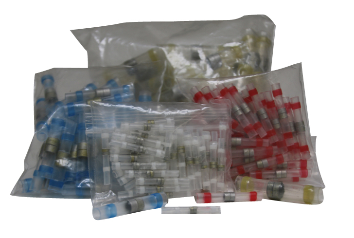 Close up photo showing a bag of 50 pieces of each of the 4 different sizes of TTP solder shrink connectors